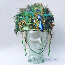 Sculpted leather peacock headpiece.