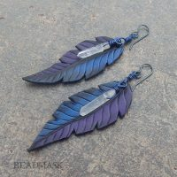 fantasy raven feather and quartz crystal earrings