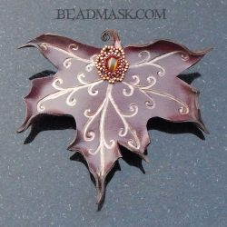 Leather maple leaf barrette with genuine tigers eye