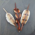 leather owl feather barrettes