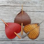 Leather birch leaf barrettes in fall colors.
