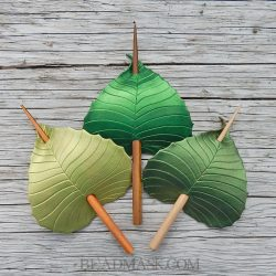 Leather birch leaf barrettes in shades of green.