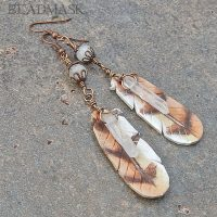 leather owl feather earrings