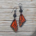 leather monarch butterfly wing earrings with glass flowers