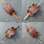 Leather oak leaf barrettes in brown